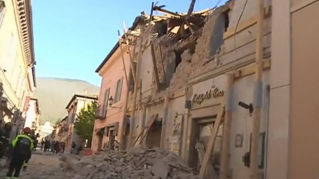 Firefighters attend a damaged building in Norcia, Italy, following an earthquake on Sunday, 30 October 2016