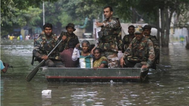 Indian army soldiers rescue flood affected people in Chennai, India, Thursday, Dec. 3, 2015.