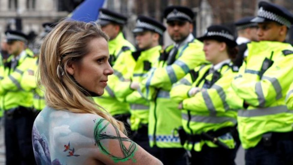 A climate change activist with her body painted demonstrates around Parliament Square during the Extinction Rebellion protest in London, Britain April 23, 2019
