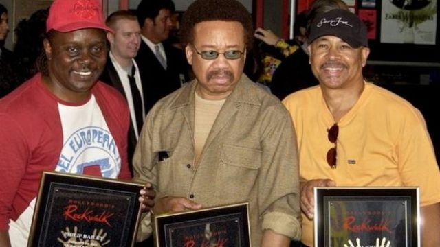 Philip Bailey, (left), Maurice White (centre) and Ralph Johnson, of Earth, Wind & Fire hold up the plaques from their induction at the Hollywood Rock Walk at a ceremony in Los Angeles. (07 July 2003)
