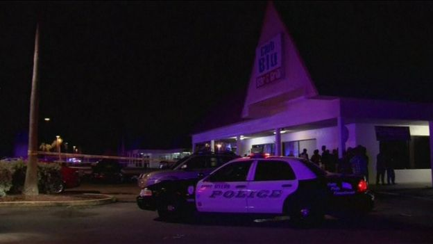 Police cars gathered outside Club Blu in Fort Myers
