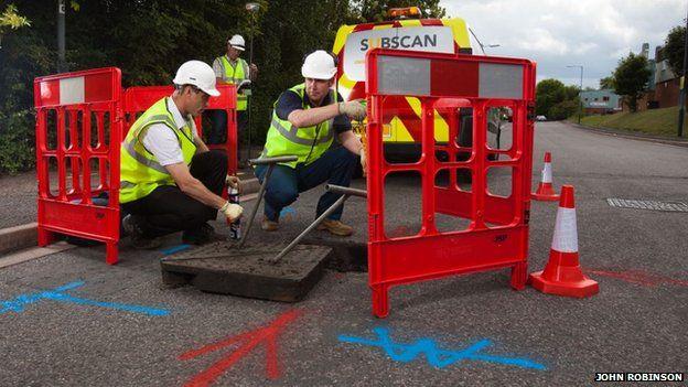 workmen doing survey work