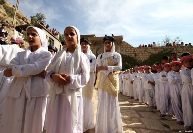Girls and boys from a Yazidi religious school sing hymns and prayers