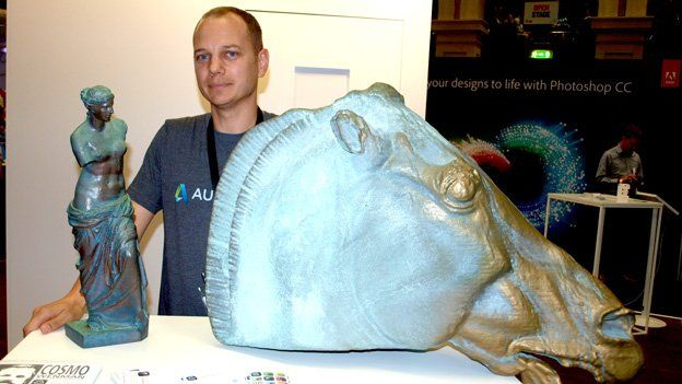 Autodesk's Jesse Harrington with 3D printed sculptures made on a Makerbot printer