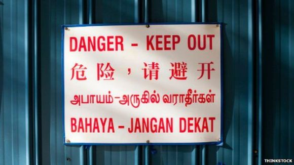 Danger - Keep out sign in four languages