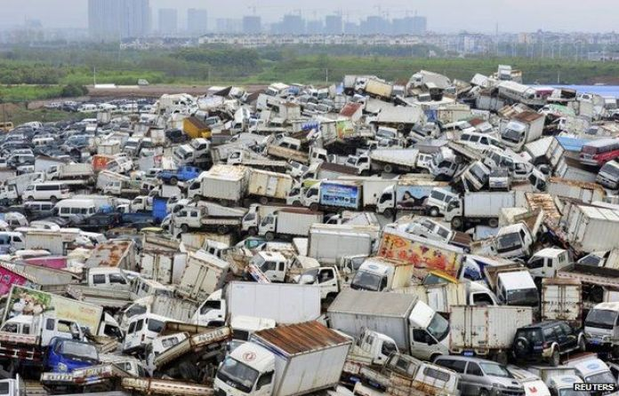 Scrapped high-emission vehicles are seen piled up at a dump site of a recycling centre in Yiwu, China.