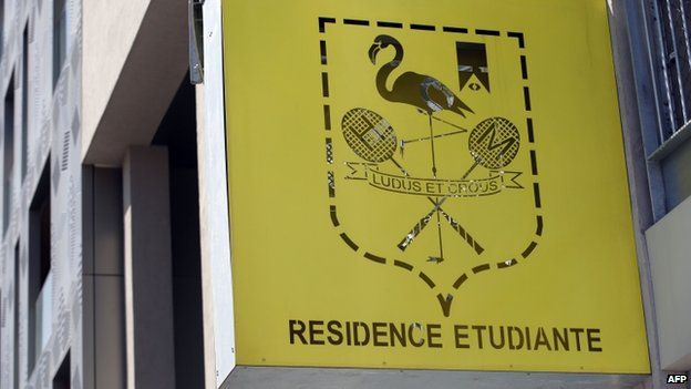 A picture taken on April 22, 2015 shows the logo of the student residence where an It student, suspected of planning a church attack in France, lived in Paris