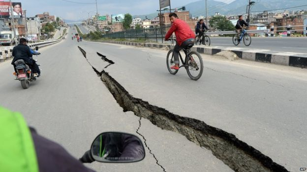 Damaged roads are seen after an earthquake on the outskirts of Kathmandu (26 April 2015)