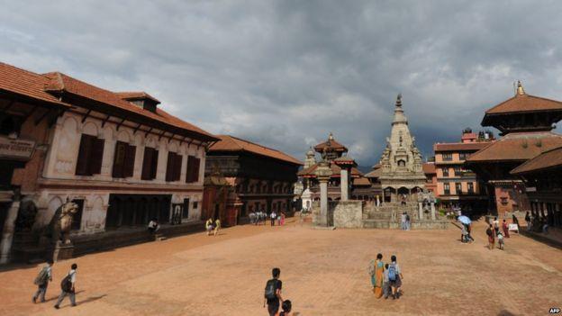 Nepalese pedestrians pass through Bhaktapur Durbar Square in Bhaktapur (July 21, 2011)