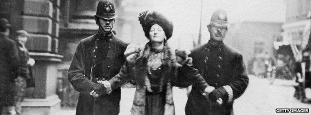 A suffragette is led away by police during a demonstration for women's voting rights in London, 1906