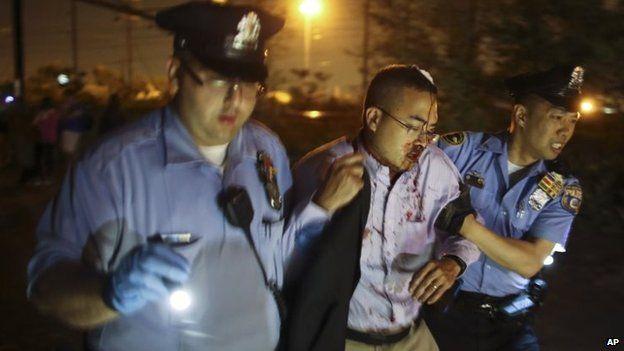 Police help an injured passenger. Photo: 12 May 2015