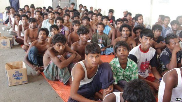 A group of rescued migrants mostly Rohingya from Myanmar and Bangladesh gathered on arrival at the new confinement area in the fishing town of Kuala Langsa in Aceh province on May 15, 2015.