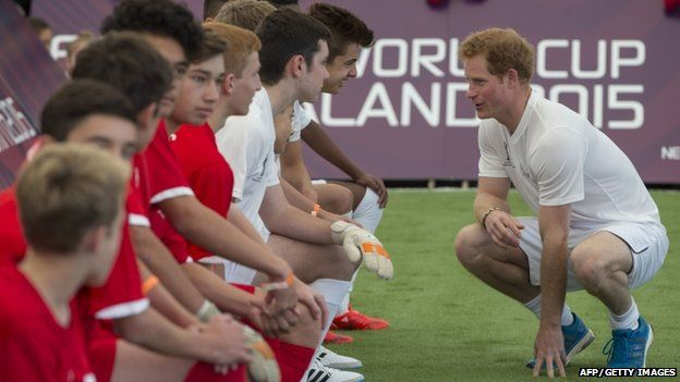 Prince Harry talking to teammates during a five-a-side football match