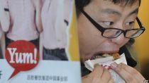 A man eating at KFC in China