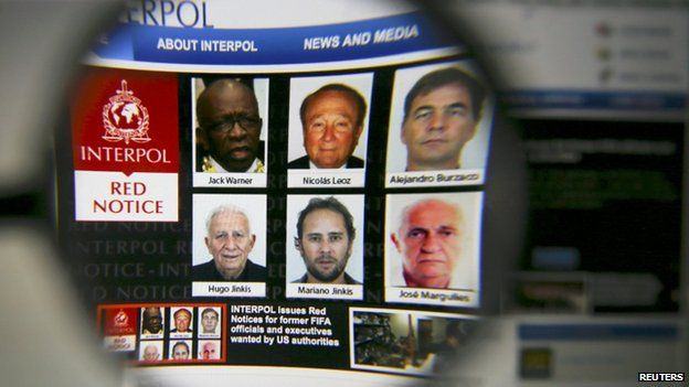 The homepage of the Interpol website is seen through a magnifying glass in this picture illustration taken in Berlin, Germany on 3 June 2015.