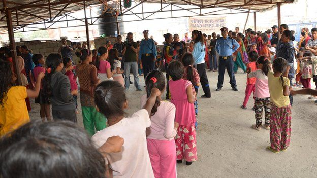 Children line up to receive self-defence instruction from the Nepal Police