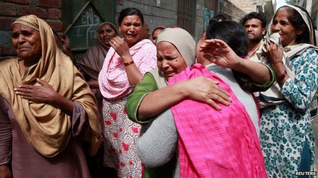 Pakistani women mourn the death of a relative in the church attack