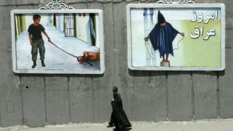 Vallas en Irán mostrando las torturas de Abu Ghraib.