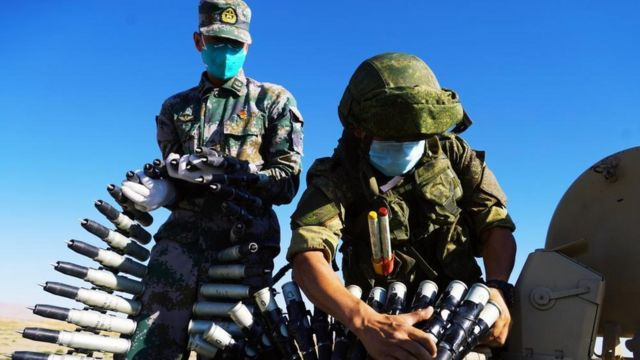 Chinese Soldier training Russian soldier using Chinese tanks