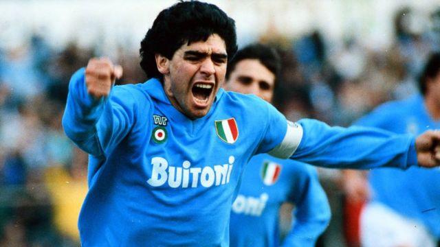 Diego Maradona celebrates scoring a goal with Napoli