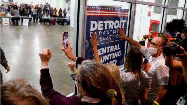 Trump supporters demonstrate outside a vote counting center in Michigan