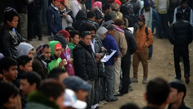 People queue up
