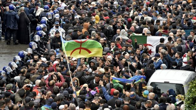 Algerian demonstrators in the streets of the capital Algiers mark the second anniversary of the start of their popular movement