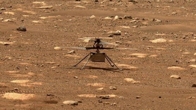 The helicopter is on the surface of Mars.