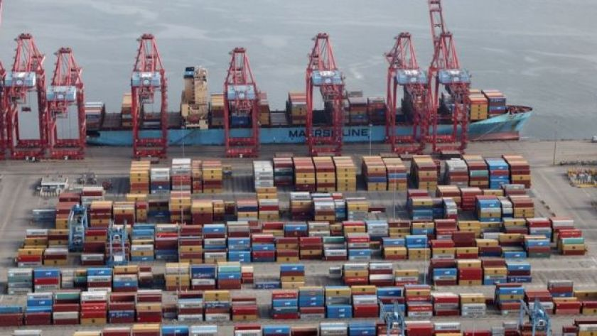 Shipping containers are unloaded from a ship to a container terminal at the Port of Long Beach-Port of Los Angeles complex, April 2021