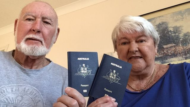 John and Margaret Sparks show their Australian passports