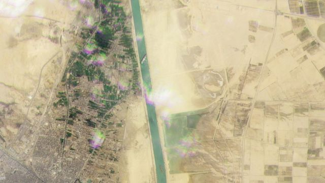 A satellite image of the tanker blocking the Suez Canal