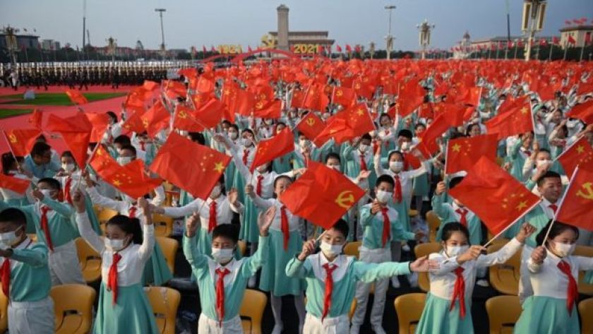 Students with flags of China and the Chinese Communist Party in government act