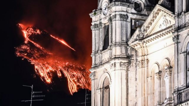 Lava spewing in the background of a cathedral