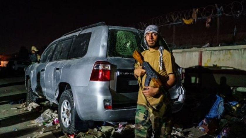 Taliban guard near Kabul airport on Thursday