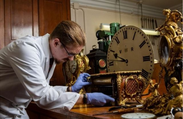 A man cleans a watch