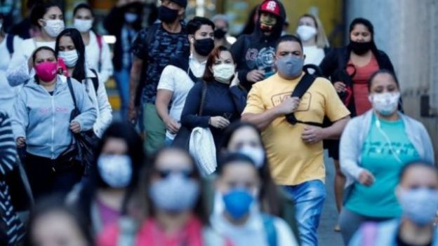 People walking with masks on the street