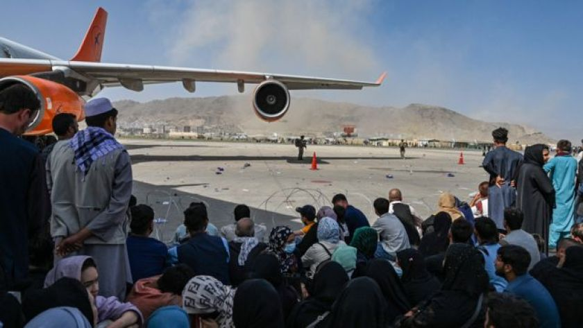 Afghans waiting to leave Kabul airport on August 16, 2021