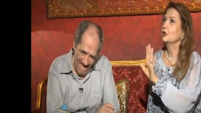 The late singer Maher Al-Attar and his wife during a TV interview years ago