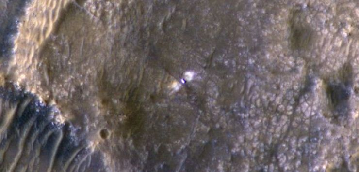 Enhanced colour image of the rover taken by the Mars Reconnaissance Orbiter high above the planet