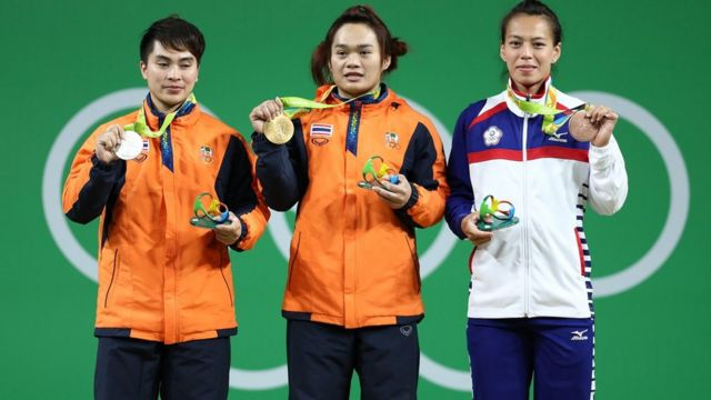 AUGUST 08: (L-R) Silver medalist Pimsiri Sirikaew of Thailand, gold medalist Sukanya Srisurat of Thailand and bronze medalist Hsing-Chun Kuo of Chinese Taipei pose on the podium during the medal ceremony for the Women's 58kg Group A weightlifting contest the on Day 3 of the Rio 2016 Olympic Games