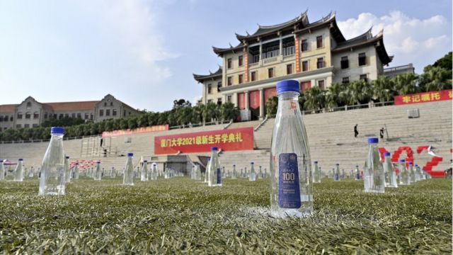 The stadium of Xiamen Univeristy, which should have been occupied by freshmen, is seen with bottled water instead on September 13, 2021 in Xiamen, Fujian Province of China. Affected by the COVID-19 epidemic, Xiamen Univeristy temporarily decides to hold the new semester opening ceremony online.