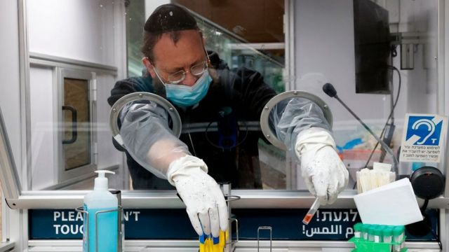 An Israeli medic collects test samples
