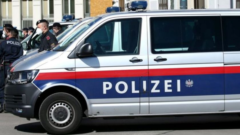 Austrian police vehicle, with officers at the side