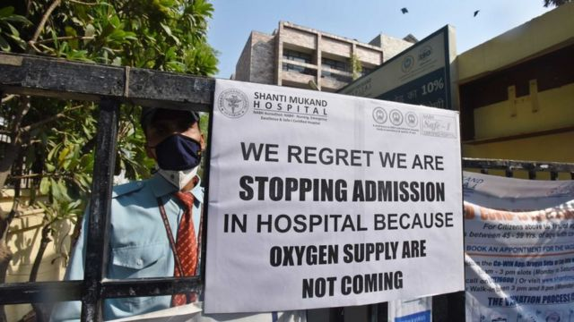 Announcement outside a hospital in Delhi that there is no oxygen available.