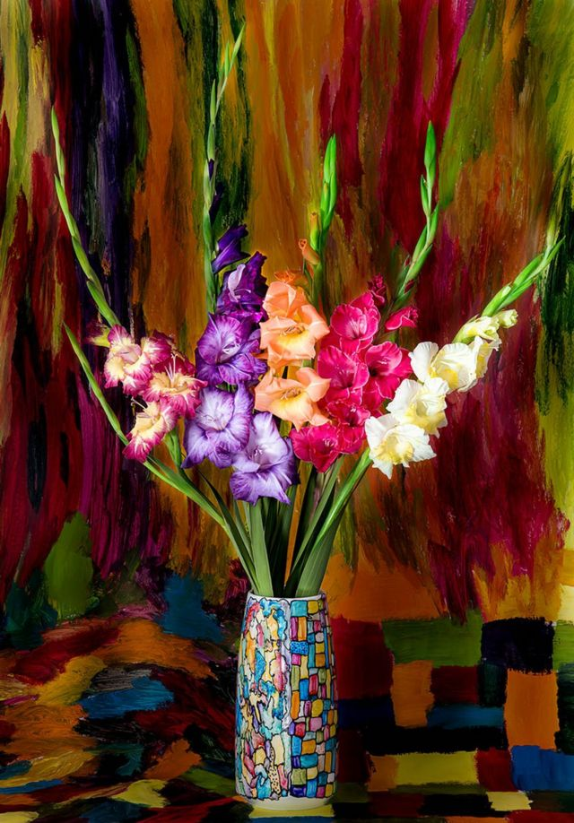Colourful flowers in a colourful vase with a painted background behind