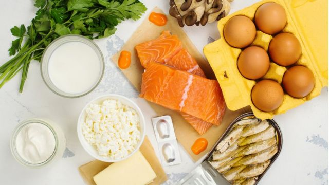 Salmon, eggs, canned fish and other foods that are a source of vitamin D on the table