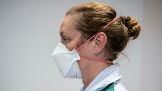 A woman wearing a facial mask