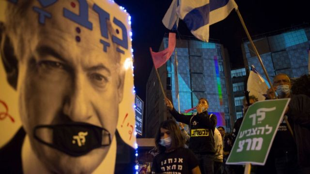 Israelis demonstrate against Benjamin Netanyahu on March 20, 2021 in Jerusalem
