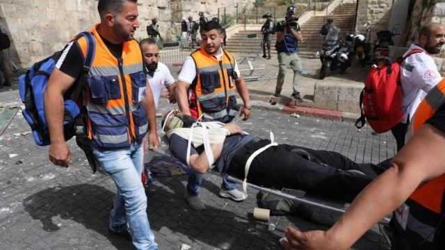 The Red Crescent transports wounded people in Jerusalem