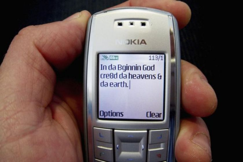 Old cell phone with text message on screen